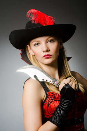 Woman pirate with sharp knife photo