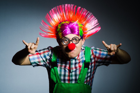 disgruntled: Funny clown against the grey background
