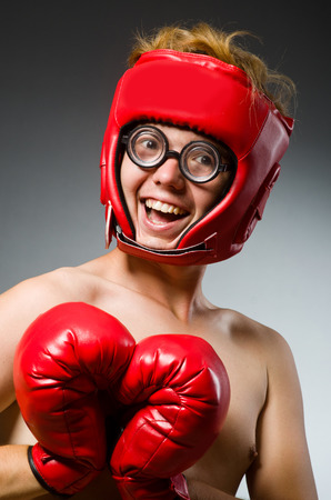 feeble: Funny nerd boxer in sport concept
