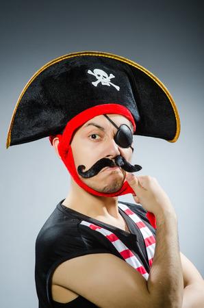 Funny pirate in the dark studio photo