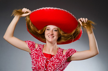 mexican woman: Mexican woman wearing red sombrero
