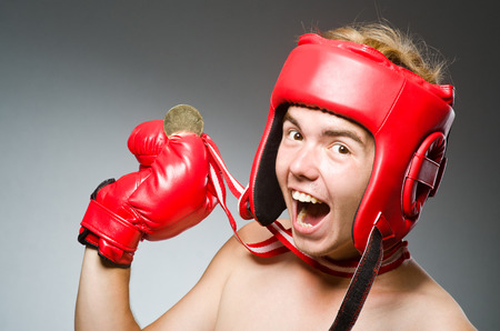 Funny boxer with winning gold medal photo