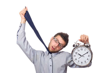 Man with clock trying to meet the deadline isolated on white photo