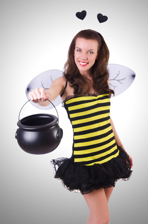 honey blonde: Woman in bee costume isolated on white
