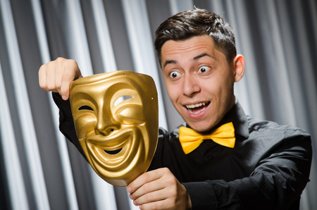 impostor: Funny concept with theatrical mask Stock Photo