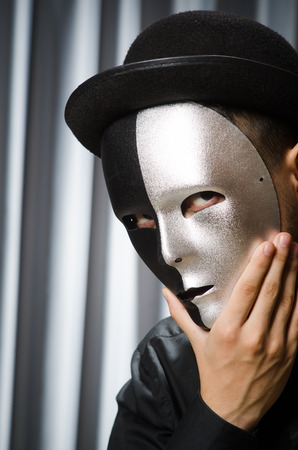 insincere: Funny concept with theatrical mask Stock Photo