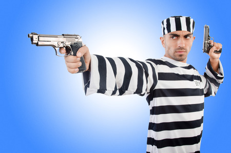 lawbreaker: Prisoner with gun isolated on white Stock Photo