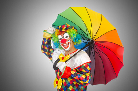 buffoon: Clown with umbrella isolated on white