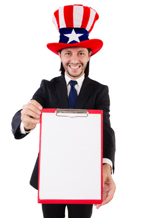 Businessman wearing USA hat with paper on white photo