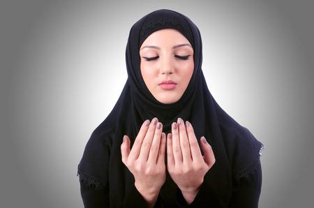 burka: Muslim young woman wearing hijab on white