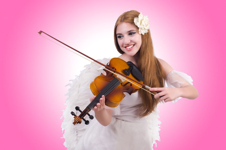 virtuoso: Young violin player isolated on white