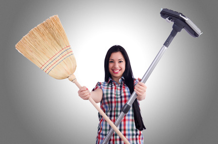 Young housewife doing housekeeping on white photo
