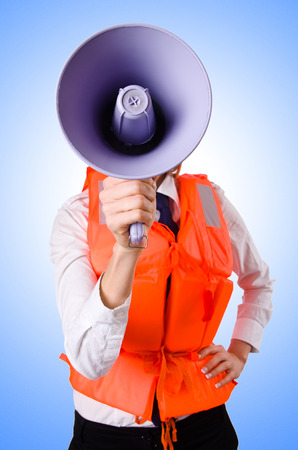 Young woman with vest and loudspeaker on white photo