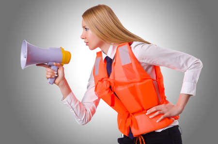 lifejacket: Young woman with vest and loudspeaker on white