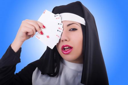 pious: Nun playing cards on white Stock Photo