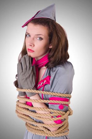 stewardess: Female stewardess tied with rope Stock Photo
