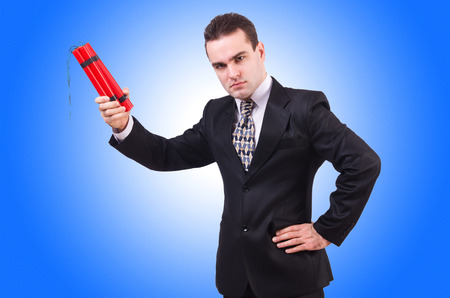 Businessman with dynamite isolated on white photo