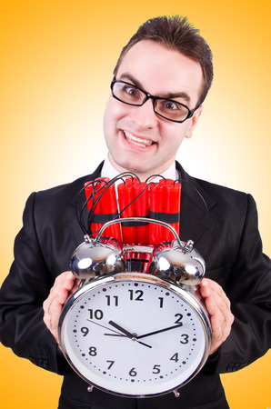 sabotage: Man with time bomb isolated on white