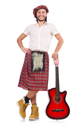 scot: Scotsman playing guitar isolated on white