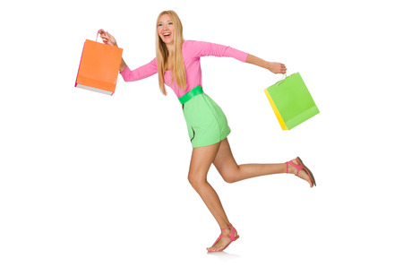 hurrying: Woman with shopping bags isolated on white