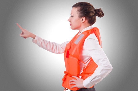 lifejacket: Woman in vest pressing virtual buttons Stock Photo