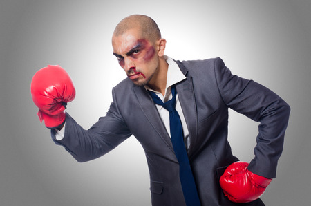 bruised: Badly beaten businessman with boxing gloves