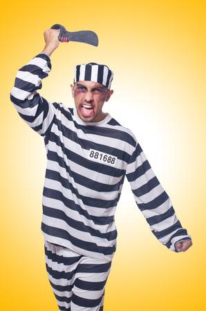 lawbreaker: Prisoner with knife isolated on white Stock Photo