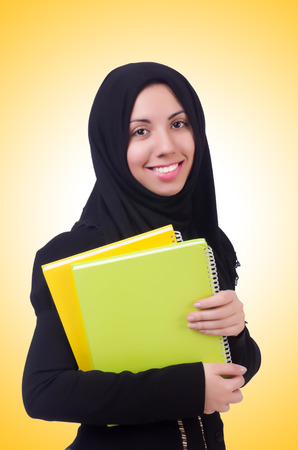 learning  pray: Young muslim female student with books