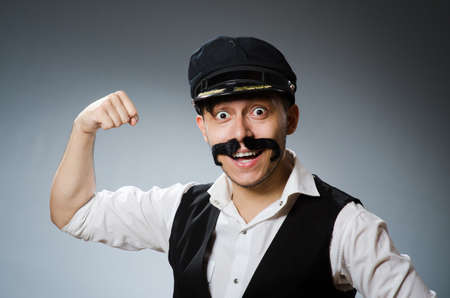 driver cap: Funny taxi driver wearing peaked cap Stock Photo