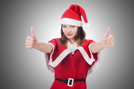 hitch hiker: Young woman in red santa costume on white