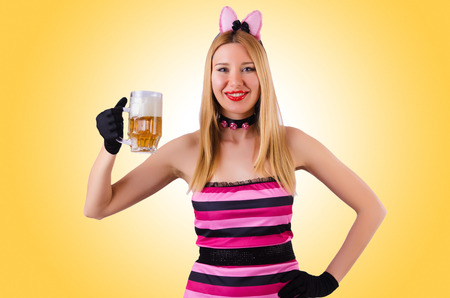 Young waitress with beer on white photo