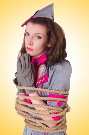 gefesselt: Female Stewardess mit einem Seil gefesselt Lizenzfreie Bilder