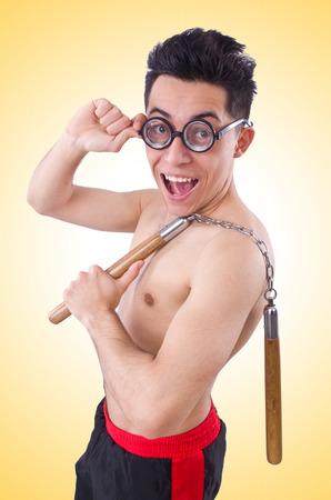 funny guy: Dr�le de type avec nunchucks sur blanc Banque d'images