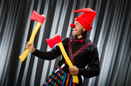 Funny clown with red axe photo