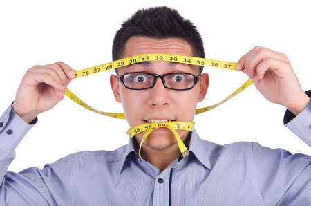 losing control: Man with centimeter in dieting concept