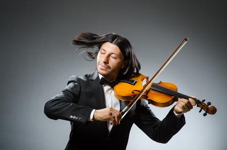 solo violinist: Man violin player in musican concept