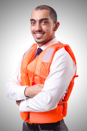 lifejacket: Man in life jacket isolated on white