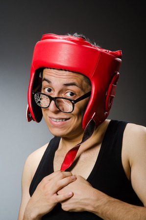 frail: Funny boxer with red gloves against dark background Stock Photo