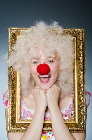 passe: Funny clown with picture frame Stock Photo