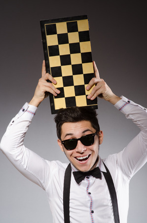 chess board: Funny chess player with board