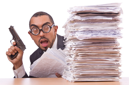 Angry businessman with stack of papers photo