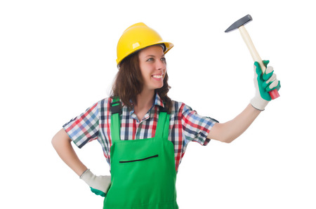 Young woman with hammer on white photo