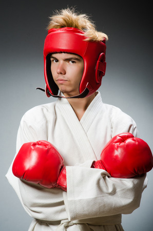 feeble: Funny boxer against dark background