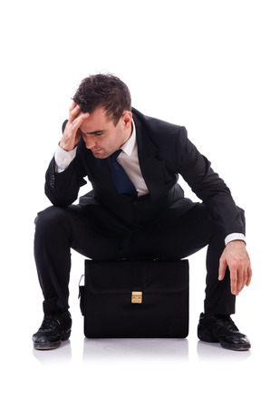disillusioned: Sad businessman isolated on the white