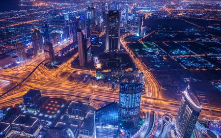 arabic architecture: Panoram of night Dubai during sunset