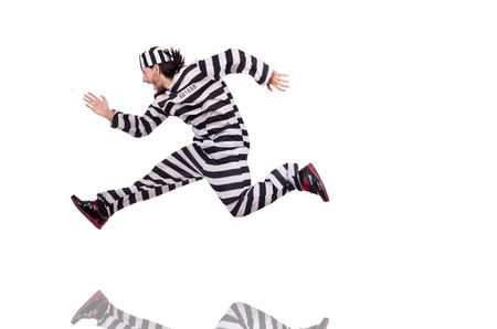 escaping: Prison inmate isolated on the white background