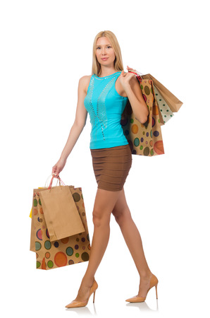 Woman with shopping bags isolated on white photo