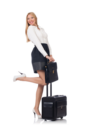 Businesswoman with luggage isolated on the white photo