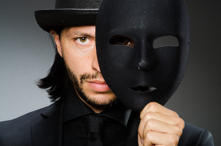 Funny concept with theatrical mask Stock Photo