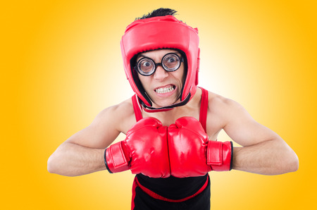 feeble: Funny boxer isolated on the white background